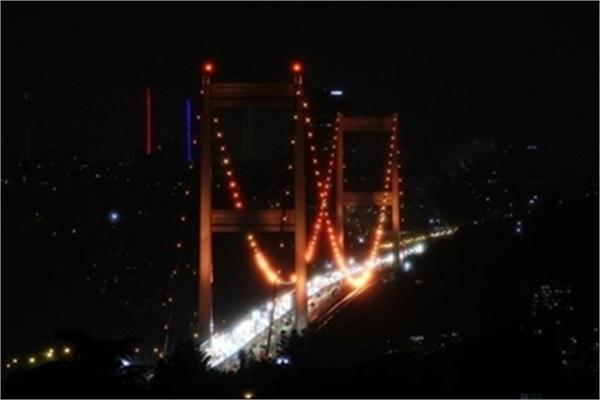Istanbul's Fatih Sultan Mehmet Bridge Illuminated in Orange Lights